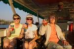 People enjoying drinks on a sundowner cruise