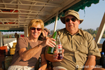 Man and woman drinking soda on a sundowner cruise