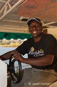 Tourist river boat captain driving a sundowner cruise