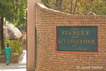 The entrance sign to and a grounds keeper at the Stanley and Livingstone Hotel