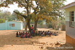 Children at Chintimba Primary School holding class outside due to lack of classroom space
