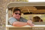 Man in back of safari vehicle