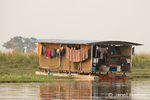 Houseboat with laundry hanging on the outside in the Chobe River