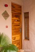 Beautiful wood door to a room at the Cresta Mowana Safari Lodge