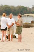 People enjoying a safari sundowner party on the beach beside the Zambezi River