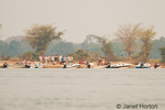People enjoying a sundowner on an island in the Zambezi River
