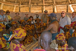 Tourists and Goba women dancers in a hut doing a formal greeting of the tribal chief at the Chiawa Cultural Village