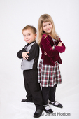 Brother and Sister (three year old boy and six year old girl) posing, showing a spunky attitude