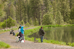 Hispanic and Causian families fishing in Donnie Lake