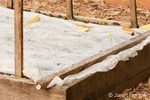 Raised vegetable garden beds prepared for dormancy with garden fabric cover placed on them