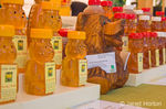 Bottles of Misty Mountain honey by in many varieties for sale at a farmer's market