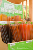 Display box of HoneyStix at a Misty Mountain honey booth at the farmer's market