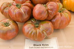 Pile of Black Krim heirloom tomatoes at a farmers market