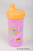 Pink & yellow sippy cup close-up