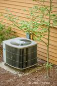 Heat pump installed beside a home.
