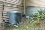 Heat pump installed beside a home.