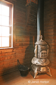 Antique Pot-bellied Wood-burning Stove and ashes bin at the Thorp Grist Mill