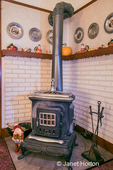 Woodburning stove with Autumn and Thanksgiving decor, in a home