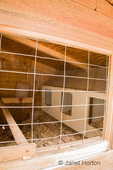Nesting area of inside of hand-built chicken coop, as seen from the inside