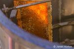 Frame of honey in a honey extractor machine.