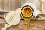 Honey extractors have a honey gate near the bottom that is used to empty the extractor of the raw honey (propolis) into a food-grade bucket