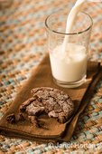 Snack of a chocolate sugar cookie and milk
