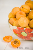 Bowl of apricots in handmade pottery bowl, to be prepped for dehydrating.  Select fresh and fully ripened fruits.