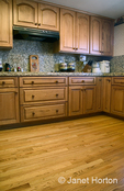 Kitchen with Oak cabinets & wood floor