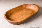 This hand-carved, antique bread or dough trough contains the mess of mixing and kneading, and minimizes cleanup.