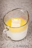 Melting butter in warm milk as part of making monkey bread.