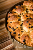 Freshlybaked Monkey bread, also called monkey puzzle bread, sticky bread, African coffee cake, golden crown, pinch-me cake, pluck-it cake, bubbleloaf and monkey brains is a sweet, sticky, gooey pastry served in the United States for breakfast.
