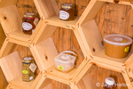 A variety (honey, creamed honey, bee pollen, honeycomb) of bee products produced by Bees in the 'Burbs beekeepers, ready for sale
