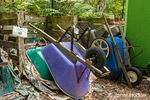 "Upside-down wheelbarrows used as weight on a compost pile that is ""cooking"""