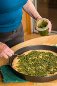 Spoon the pesto sauce onto the multi-grain partially-baked crust prior to adding other toppings.
