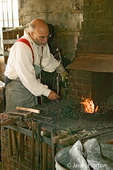 Blacksmith standing at the forge