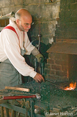Blacksmith going in for the heat