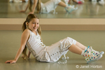 Eight year old girl resting during Hip-hop dance lesson class