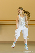 Hip-hop dance dress rehearsal showing an eight year old girl