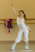 Eight year old girl dancer doing a disco dance move