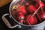 Put similar sized beets together with enough boiling water to cover them and cook until tender, usually about 30 to 45 minutes in an open pot.