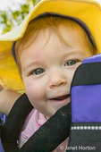 Close-up of 9 month old girl in a child backpack