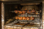 Chickens being barbecued on a rotisserie at CASEM, a non-profit artisan cooperative dedicated to enhancing the economic and social well-being of local women artists.