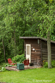 Attractive garden shed in a shaded rural setting