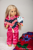 American Girl doll carrying her pet to put it it bed