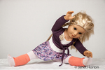 American Girl doll doing her stretches before dance class