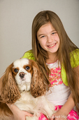 Nine year old girl posing with five year old Cavalier King Charles Spaniel, Mandy