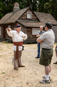 Tour guide giving a talk to tourists at Fort Nisqually Living History Museum