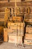 Coils of rope and antique tools, including a pitchfork and rake, at Fort Nisqually Living History Museum
