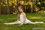 Seven year old showing how well she can do the splits in her backyard