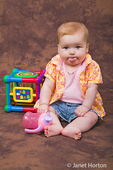 6 month old girl playing with toys